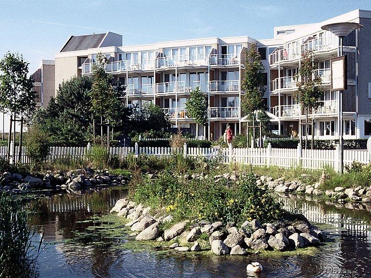 Ferielejlighed Am Park 40 m2 Seeseite med balkon og barneseng