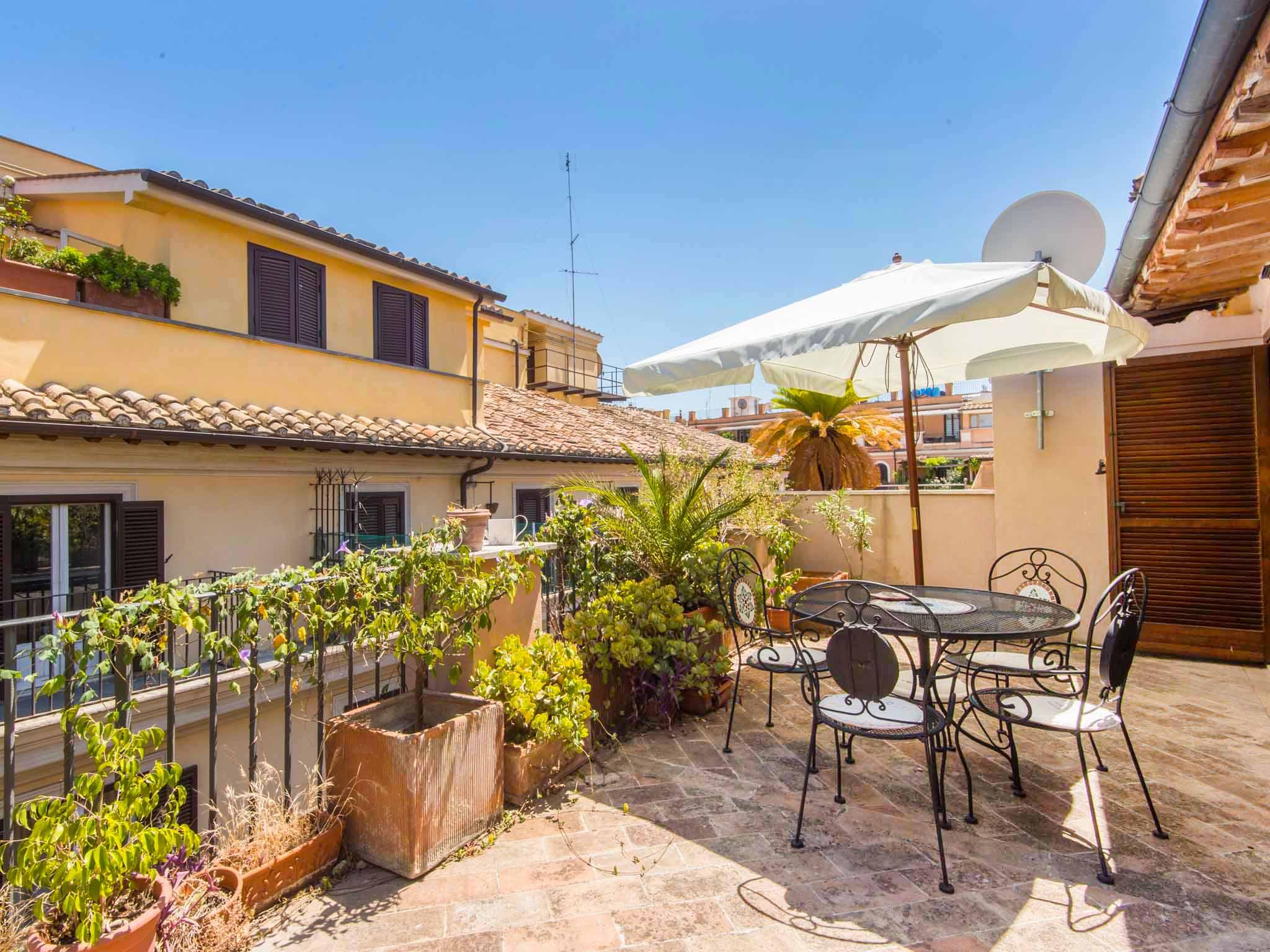 Apartment condotti terrace in rome historical city center for 702 weddings terrace